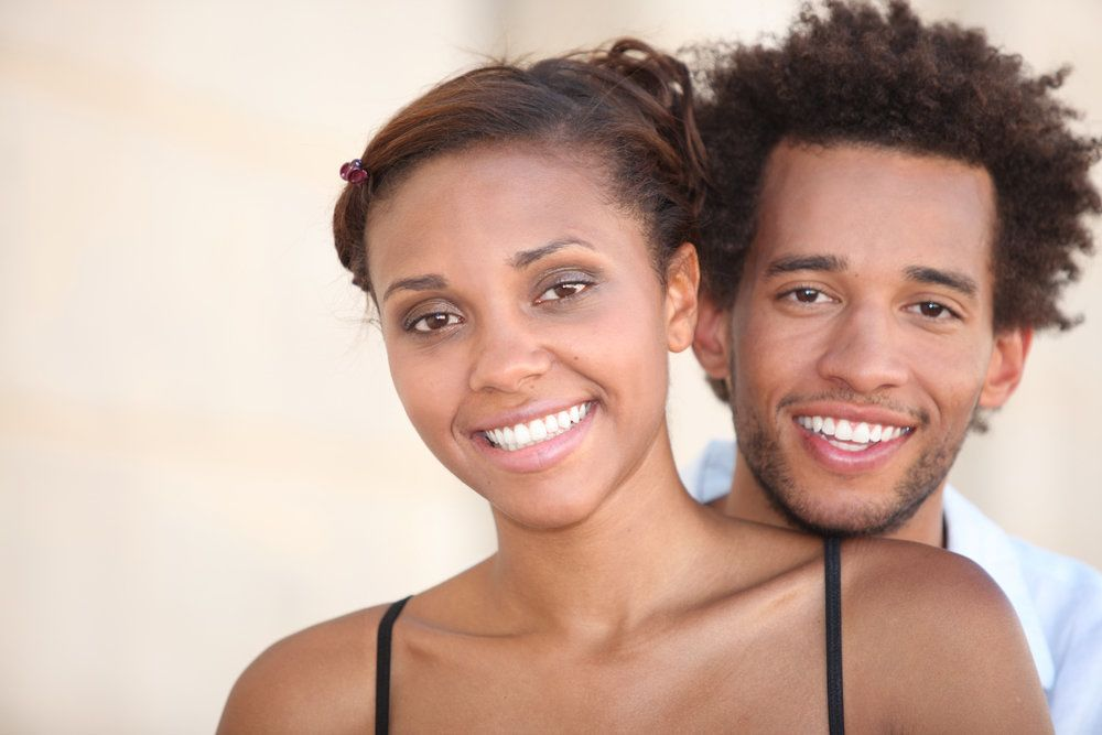 image of couple smiling with dental crowns
